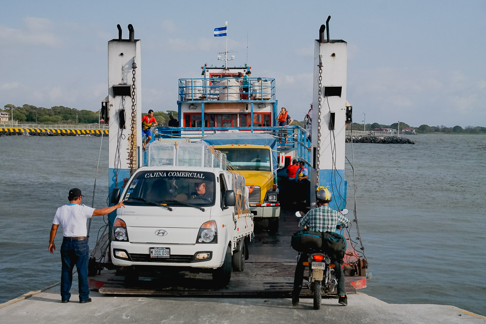 two trucks, three cars and a motorbike all fit on this tiny ferry...