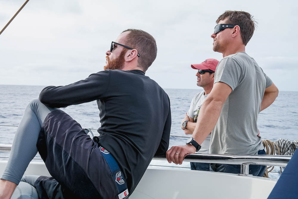 Engineer, Captain and Mate considering sail configs on the delivery from Newport RI to SXM