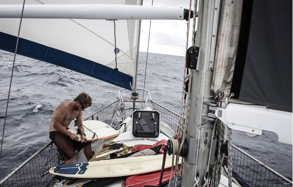 Rufus' photo of Wilhem repairing boards as we crossed the Atlantic, ready to surf in Brazil!